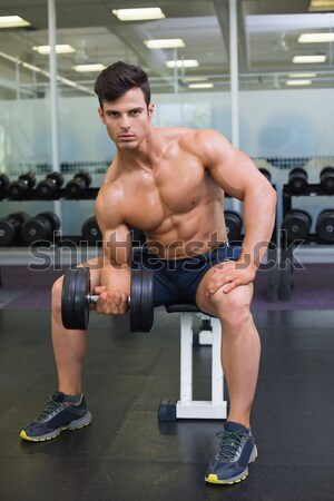 Shirtless muscular man using resistance band in gym Stock photo © wavebreak_media