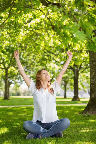 Pretty redhead raising her arms in the park Stock photo © wavebreak_media