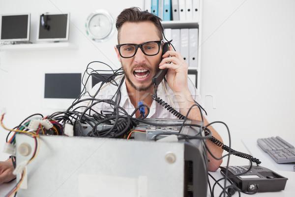 Angry computer engineer making a call Stock photo © wavebreak_media