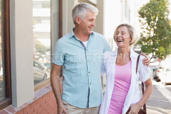 Happy mature couple walking in the city Stock photo © wavebreak_media