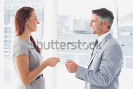 Executives exchanging business card in office Stock photo © wavebreak_media