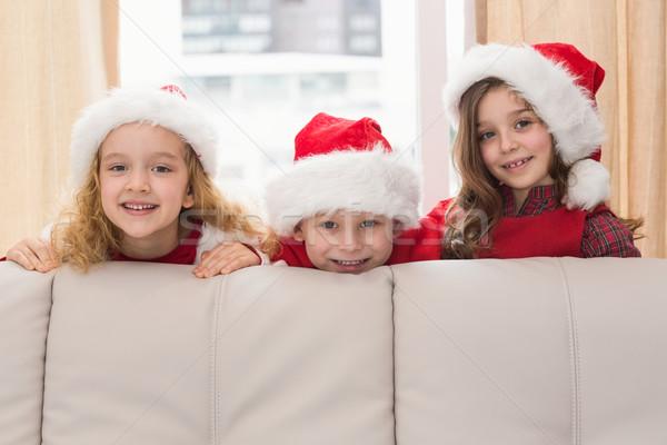Feestelijk weinig broers en zussen glimlachend camera home Stockfoto © wavebreak_media