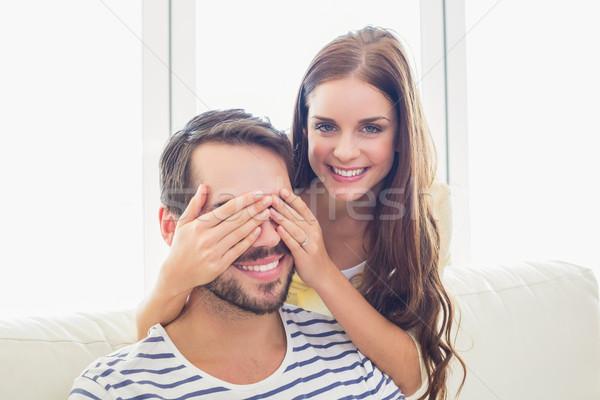 Pretty woman surprising her boyfriend Stock photo © wavebreak_media
