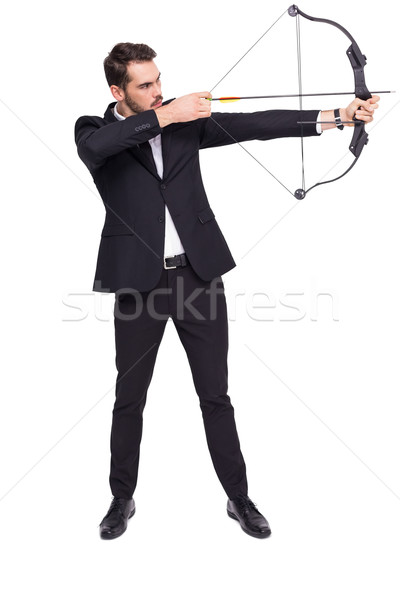 Businessman shooting a bow and arrow Stock photo © wavebreak_media