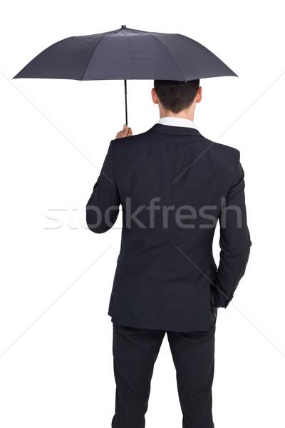 Vue arrière affaires parapluie blanche costume noir Photo stock © wavebreak_media