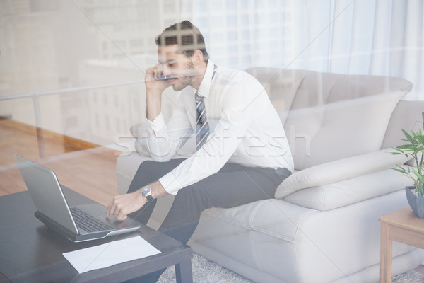 Businessman working on his couch seen through glass Stock photo © wavebreak_media