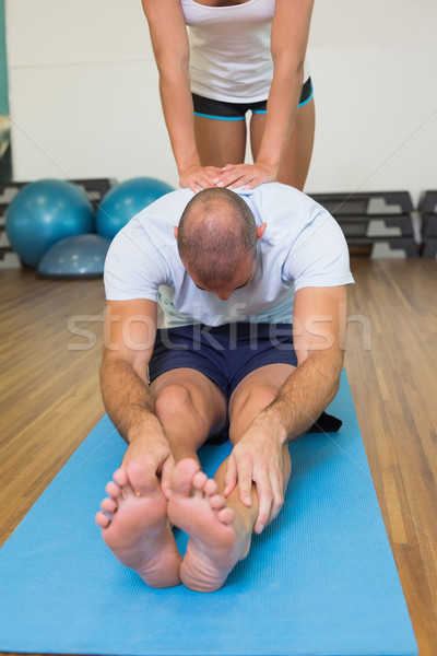 Trener człowiek fitness kobiet młody człowiek Zdjęcia stock © wavebreak_media