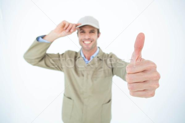 Futár visel sapka gesztikulál remek portré Stock fotó © wavebreak_media