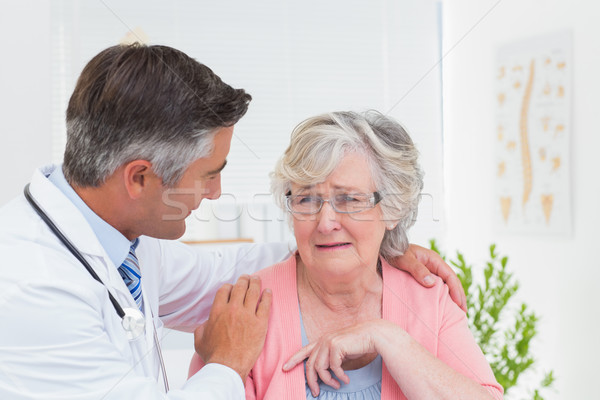 Doctor consoling senior patient in clinic Stock photo © wavebreak_media