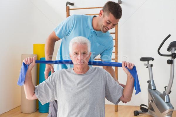 Starszy człowiek szkolenia trenerem fitness studio Zdjęcia stock © wavebreak_media
