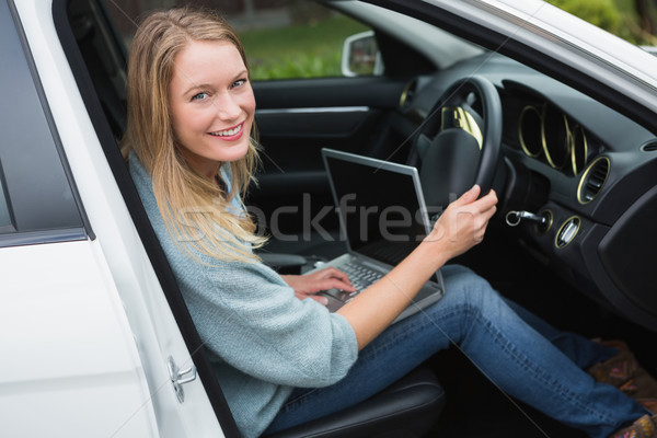 Young woman working in the drivers seat  Stock photo © wavebreak_media