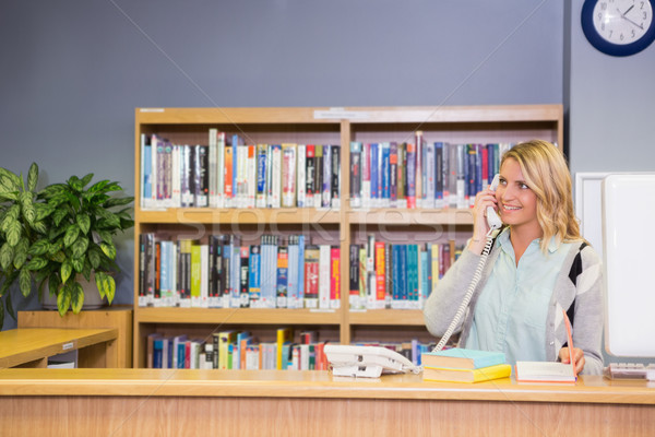 Pretty librarian working in the library Stock photo © wavebreak_media
