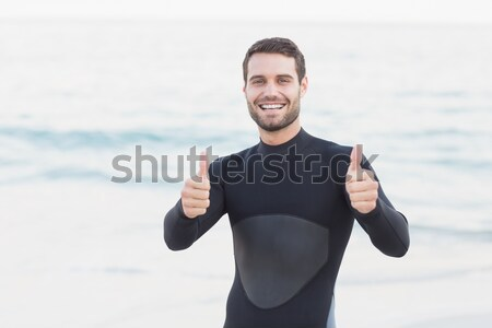 Man in wetsuit on a sunny day Stock photo © wavebreak_media