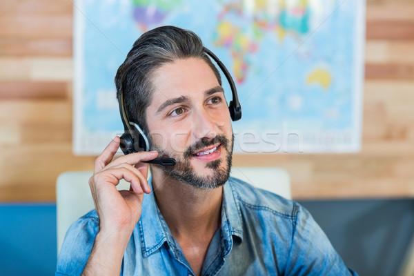 Mosolyog utazás hatóanyag telefonbeszélgetés iroda üzlet Stock fotó © wavebreak_media