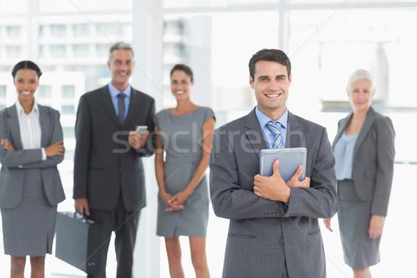 Zakenman digitale tablet collega's achter portret Stockfoto © wavebreak_media