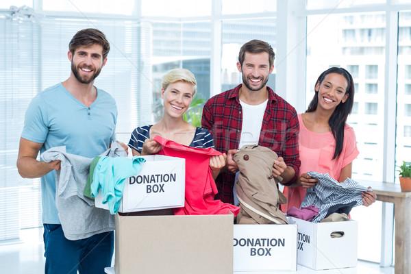 Souriant jeunes amis bénévoles vêtements portrait Photo stock © wavebreak_media
