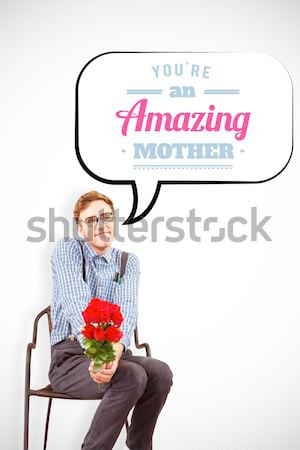 Geeky hipster holding a bunch of roses Stock photo © wavebreak_media