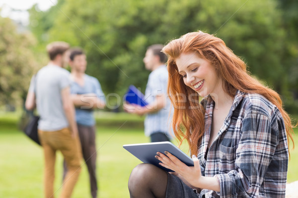 Pretty student studying outside on campus Stock photo © wavebreak_media