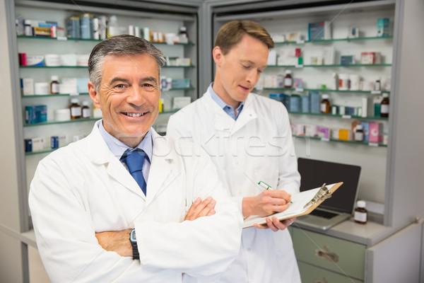 Senior pharmacist smiling at camera Stock photo © wavebreak_media