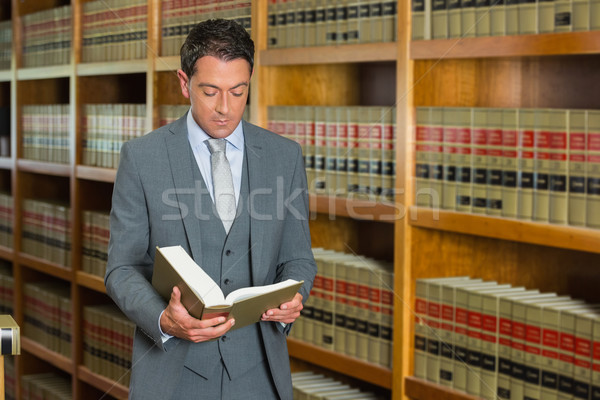 Lawyer reading book in the law library Stock photo © wavebreak_media