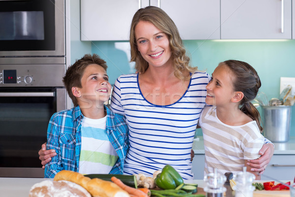 Happy family preparing vegetables together Stock photo © wavebreak_media