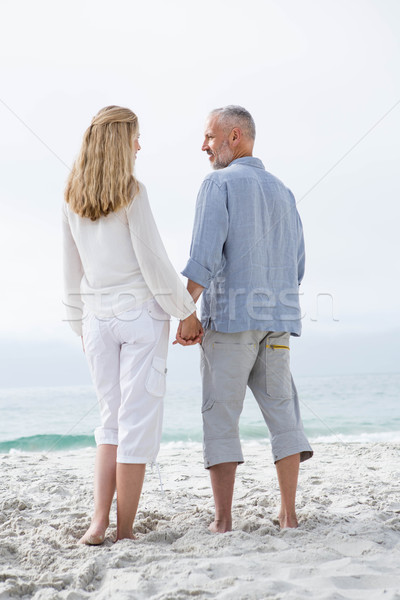 Happy couple holding hands and looking at each other Stock photo © wavebreak_media