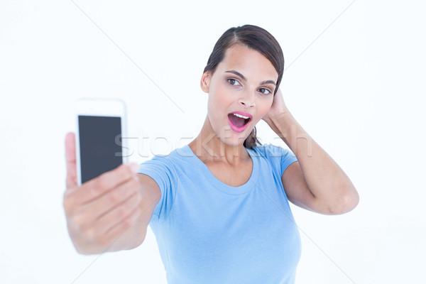 Felice bruna bocca aperta bianco femminile Foto d'archivio © wavebreak_media