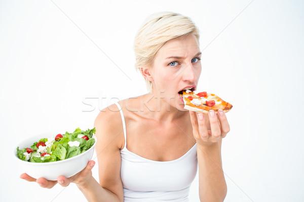Pretty woman deciding eating pizza rather the salad Stock photo © wavebreak_media