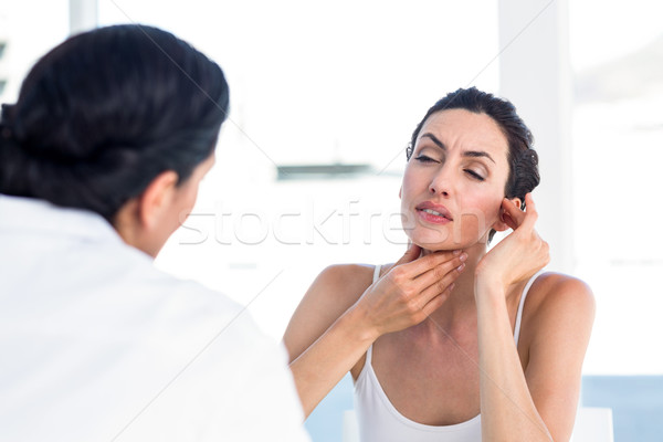 Woman showing her throat to her doctor Stock photo © wavebreak_media