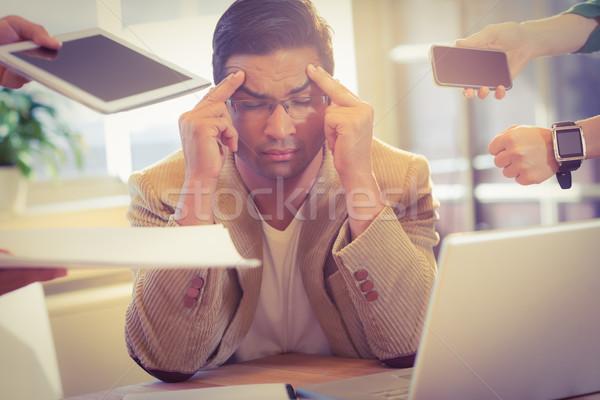 Man surrounding by work Stock photo © wavebreak_media