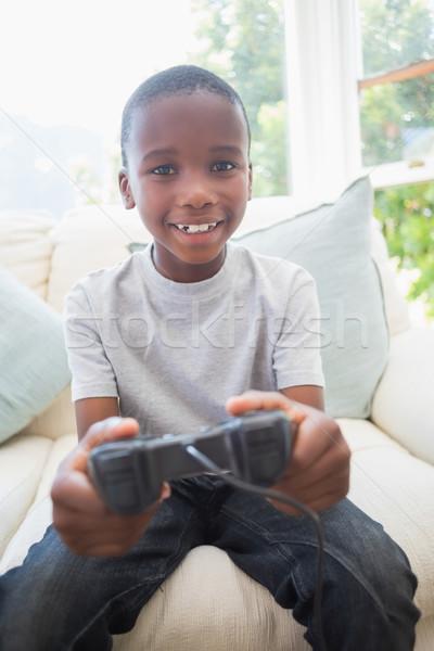 Weinig jongen spelen video games home woonkamer Stockfoto © wavebreak_media