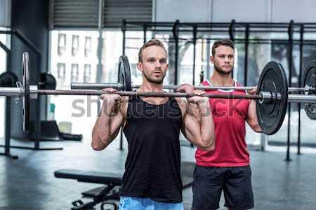Two young Bodybuilders doing weightlifting Stock photo © wavebreak_media