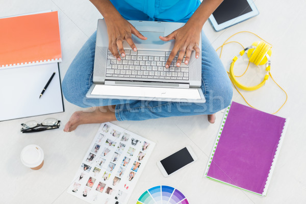 Casual businesswoman siting on the floor Stock photo © wavebreak_media