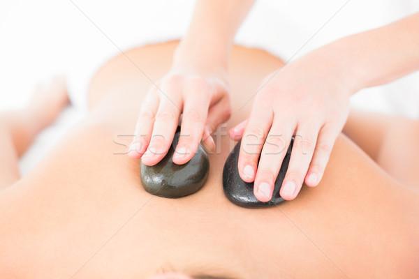 Stock photo: Woman enjoying a hot stone massage