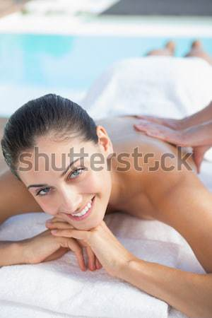 Woman lying with salt scrub on the back Stock photo © wavebreak_media