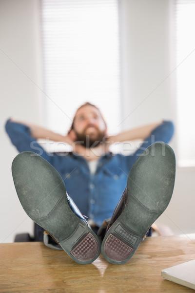 Hipster businessman relaxing at his desk Stock photo © wavebreak_media