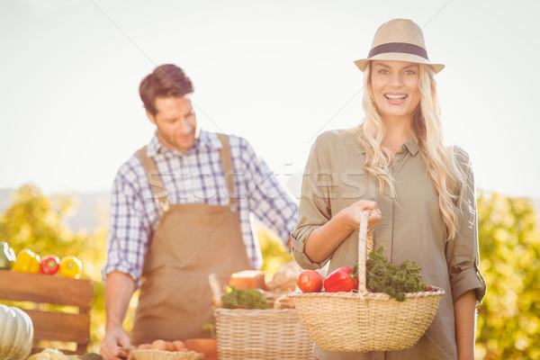 Blonde customer holding a vegetables basket Stock photo © wavebreak_media