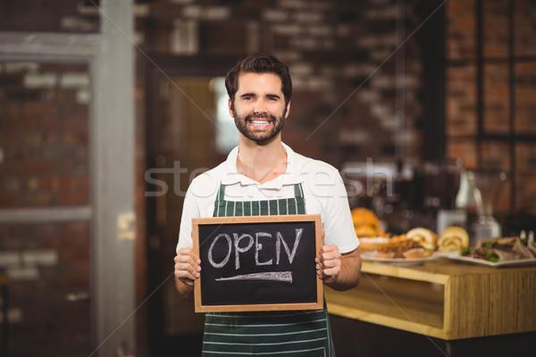 Sorridente garçom quadro-negro retrato Foto stock © wavebreak_media