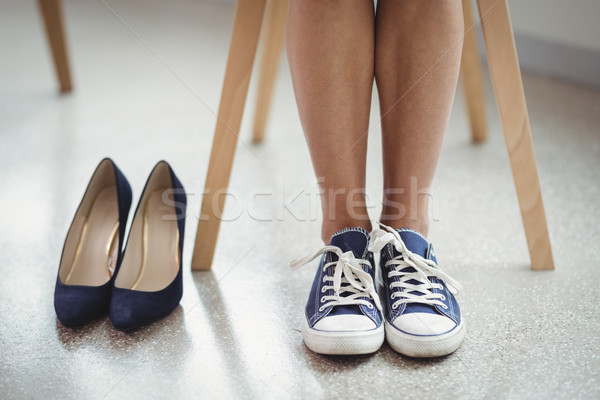 Pair of black shoes kept besides woman in canvas Stock photo © wavebreak_media