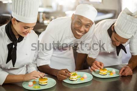 Séfek bemutat étel tányérok portré kereskedelmi Stock fotó © wavebreak_media