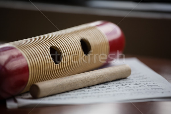 Close up of musical instrument with sheet music on wooden table Stock photo © wavebreak_media