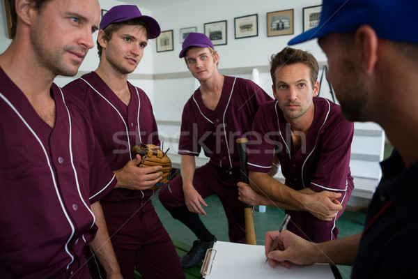 Close up of confident baseball team planning with coach Stock photo © wavebreak_media