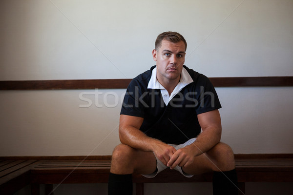 Portrait of serious rugby player on bench Stock photo © wavebreak_media