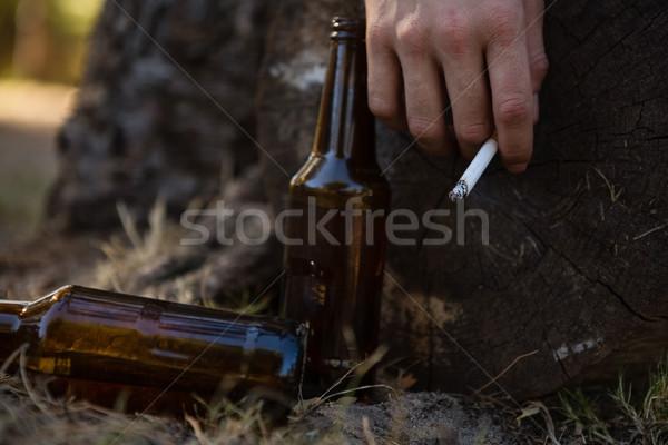 Mão homem cigarro parque Foto stock © wavebreak_media