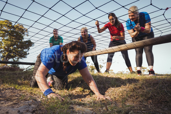 Woman being cheered bye her teammates during obstacle course training Stock photo © wavebreak_media