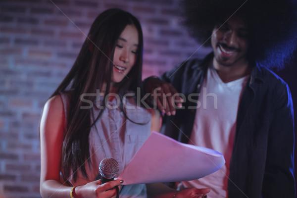 мужчины женщины чтение документы ночном клубе Сток-фото © wavebreak_media