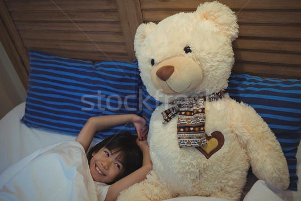 Girl yawning while sleeping in bedroom Stock photo © wavebreak_media