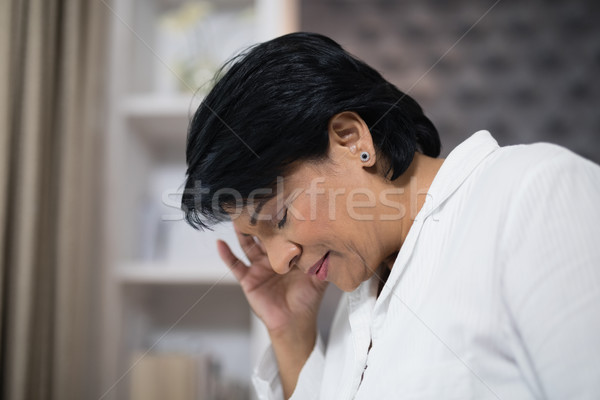 Close up of mature woman suffering with headache Stock photo © wavebreak_media