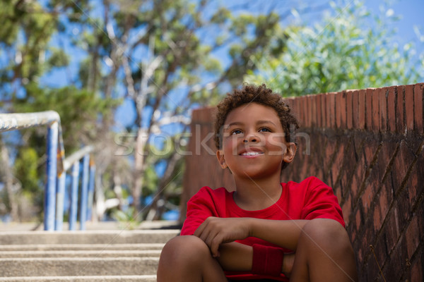 Boy sitting on staircase in the boot camp Stock photo © wavebreak_media