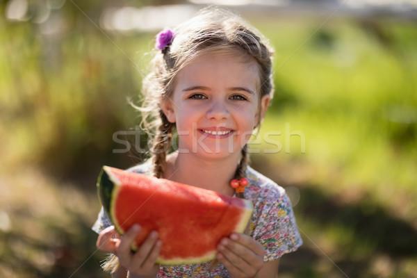 Cute girl having a watermelon slice in park Stock photo © wavebreak_media